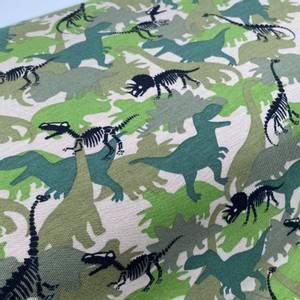 Bilde av Bomullsjersey med Dinosaurer i camo farge